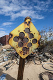 Desert junkyard traffic sign Royalty Free Stock Photography