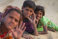 Desert kids. JAISALMER - DECEMBER 10 : Young Rajasthani kids in desert on December 10, 2010. About 40% of the total population of Rajasthan state live in the stock photos