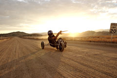 Desert Kite buggying. A man kite buggying on a desert road Stock Photography