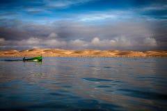 Desert and lagoon Royalty Free Stock Image