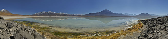 Desert lake insane vibrant reflection of mountains at altiplano, Bolivia royalty free stock photos