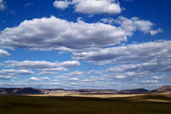 Desert landscape. Whit blue sky and clouds Royalty Free Stock Photo