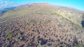 Desert landscape aerial flyover dropping down stock video footage