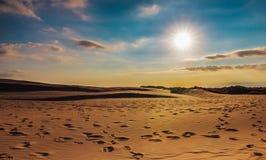 Desert landscape background. Beautiful desert landscape background clouds,sand ,sun,sun ray Royalty Free Stock Images