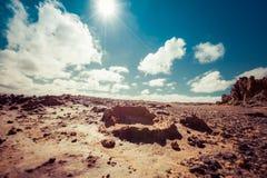 Desert Landscape - barren land under hot shining sun. Royalty Free Stock Images