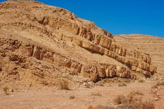 A desert landscape with a blue sky shot from the side between the rocks. A desert landscape on a Sunny day with a blue sky shot from the side between the rocks stock images