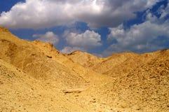 Desert landscape - bright ligh. Hills and blue sky in Arava desert, Israel, HDR image Royalty Free Stock Photography