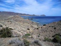 Desert landscape on the Cabo de Gata coast, Spain. Arid landscape on the remote coast of the Cabo de Gata Natural Park, Spain royalty free stock images
