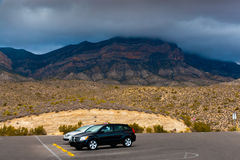 Desert landscape with cars at parking lot on overcast day in  Ne Royalty Free Stock Photos