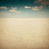 Desert landscape with clouds Stock Images