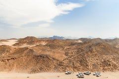 Desert landscape of Egypt. Safari cars go on the road Stock Photo