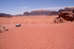 Desert Landscape. With Jeep in the distance in Wadi Rum Jordan Stock Photography