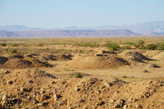 Desert landscape and mountains on horizon Royalty Free Stock Photo