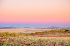 Desert landscape Namibia during sunrise Stock Photo