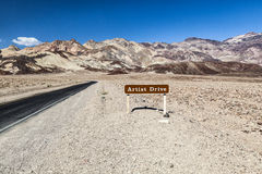 Desert landscape narrow road and sign of the scenic Artist Drive Royalty Free Stock Photography