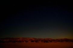 A Desert Landscape at Night Royalty Free Stock Photography
