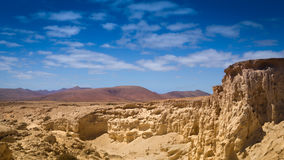 Desert landscape. Sandstone with mountains in the background Royalty Free Stock Images