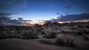 Desert Landscape after Sun Set. Desert scene turing into night during sunset also called golden hour Royalty Free Stock Image