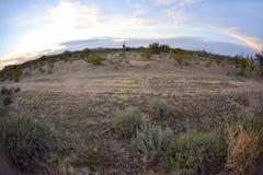 Desert landscape at sunset Stock Images