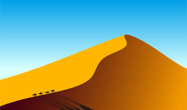 Desert landscape on the sunset and camels walking on the dunes, Royalty Free Stock Photo