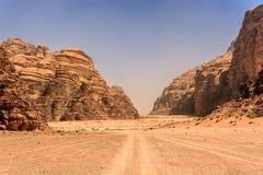 Desert landscape under blue skies. In Wadi Rum Jordan Royalty Free Stock Photo