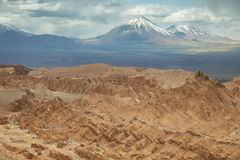 Desert landscape of Valley of Mars. With Licancabur peak at background- Atacama Desert - Chile Stock Photography