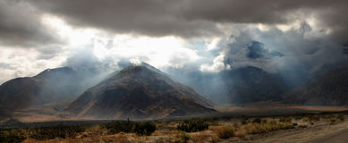 Desert Light Rays. Sunlight filtering through the Palm Springs Mountains Royalty Free Stock Image
