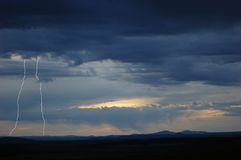 Desert Lightning. With mountains in the background Stock Photography
