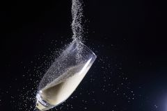 Desert liquor. This is a Desert liquor fine sand trickles into a champagne glass Stock Photography