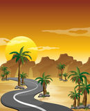 A desert with a long and winding road Stock Photo