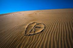 Desert Love. Stone heart with the letter & x22;K& x22; in the desert Royalty Free Stock Photo