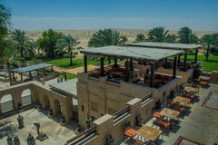 Desert luxury resort view with buildings, trees and restaurant location Stock Photos