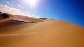 Desert meets blue sky royalty free stock images