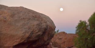 Desert Moonrise. Desert moon rising over close rocks in Utah Sunset light Royalty Free Stock Images