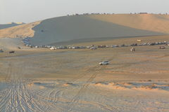 Desert Mountain full of cars of the group of people having desert car rally Royalty Free Stock Photography