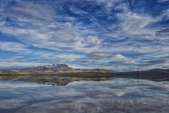 Desert Mountain with a mirror image. Image of a mountain and mirror like reflection in a desert playa filled with water Stock Photography