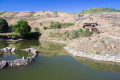 Desert mountain oasis, hut and habitation Stock Photography