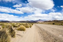 Desert and mountain over blue sky and white clouds on Altiplano,Bolivia Royalty Free Stock Images