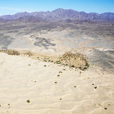Desert and mountain range. Aerial view of remote California desert with mountain range in background Stock Photos
