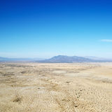 Desert and mountain range. Aerial view of remote California desert with mountain range in background Royalty Free Stock Photo
