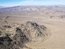 Desert and mountain range. Aerial view of remote California desert with mountain range in background Royalty Free Stock Image