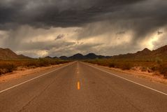 Desert Mountain Road. Dramatic desert mountain road with a storm approaching Stock Images