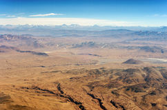 Desert and Mountains. Aerial view of dry desert and the Andes Mountains somewhere over South America Royalty Free Stock Photo