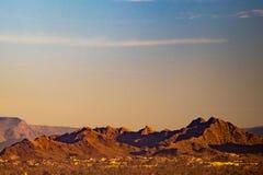 Desert mountains and vanilla sky stock photos