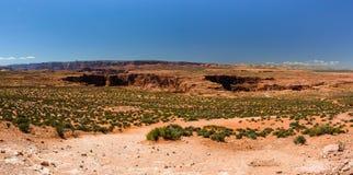 Desert near Grand Canyon Horseshoe Bend, Page,  Arizona. Desert near Grand Canyon Horseshoe Bend Page Arizona, USA civered with green plants Stock Photo