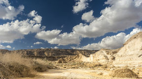 Desert Negev. Desert landscape and beautiful sky with clouds Stock Photo