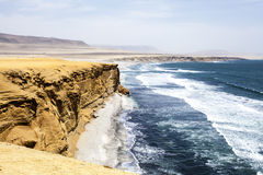 Desert next to the ocean in National Park Paracas in Ica, Peru Royalty Free Stock Image