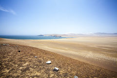 Desert next to the ocean in National Park Paracas in Ica, Peru Royalty Free Stock Images