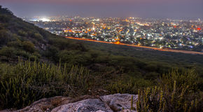 Desert at night with city lights. India Royalty Free Stock Photos
