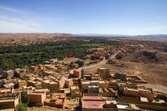 Desert oasis in Morocco. An unknown town near an oasis in the Atlas plateau, Morocco Stock Images